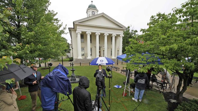 Reporters work on the front lawn of the Centre County Courthouse in Bellefonte, Pa., Monday, June 4, 2012, a day before the start of the child sexual abuse trial of former Penn State college football assistant coach Jerry Sandusky. Jury selection is scheduled to begin Tuesday. (AP Photo/Gene J. Puskar)