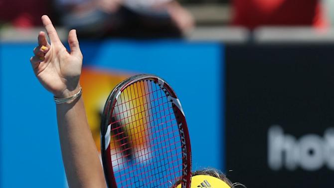 Germany's Angelique Kerber waves to the crowd following her in over Lucie Hradecka of the Czech Republic in their second round match at the Australian Open tennis championship in Melbourne, Australia, Wednesday, Jan. 16, 2013. (AP Photo/Aaron Favila)