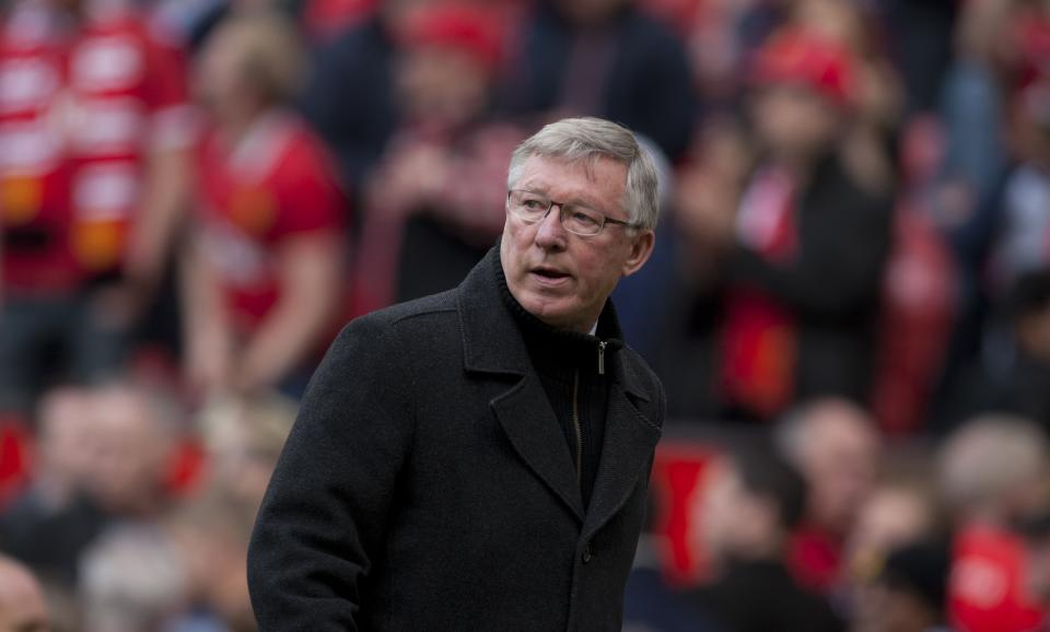 In this Sunday May 5, 2013 photo, Manchester United's manager Sir Alex Ferguson walks from the pitch after his team's English Premier League soccer match against Chelsea at Old Trafford Stadium, Manchester, England. Ferguson will step down as Manchester United manager at the end of the season after 26 years in charge. (AP Photo/Jon Super)
