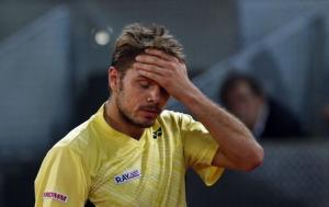 Wawrinka of Switzerland reacts after losing a point to Thiem of Austria during their match at the Madrid Open tennis tournament