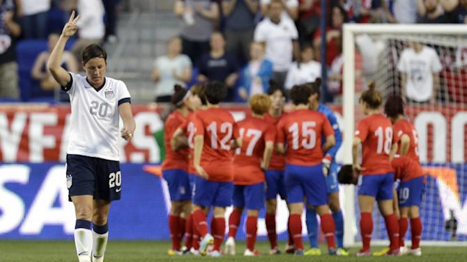United States' Abby Wambach, left, reacts after scoring a goal against South Korea during the first half of an international friendly soccer match at Red Bull Arena, Thursday, June 20, 2013, in Harrison, N.J. With the goal Wambach ties for most scored goals with former US player Mia Hamm. (AP Photo/Julio Cortez)