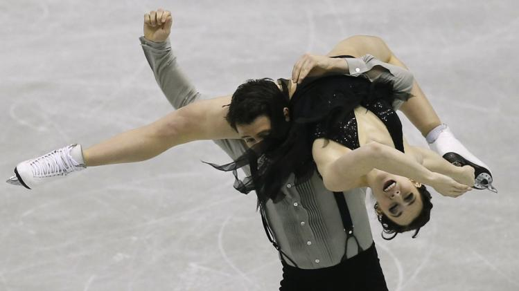 Virtue and Moir of Canada perform during the ice dance short dance at the ISU Grand Prix of Figure Skating Final in Fukuoka