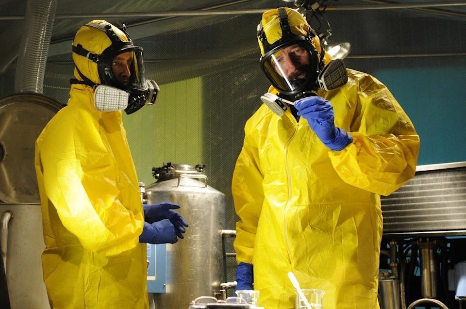 "This image released by AMC shows Jesse Pinkman, played by Aaron Paul, left, and Walter White, played by Bryan Cranston, cooking meth in a home being fumigated in the fifth season of ""Breaking Bad."" The series finale of the popular drama series airs on Sunday, Sept. 29. (AP Photo/AMC, Ursula Coyote)"