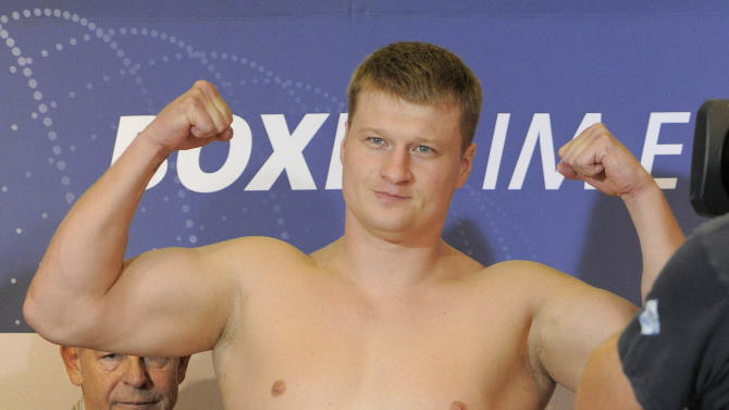 Alexander Povetkin of Russia poses at a scale during the official weighing in Erfurt, central Germany, on Friday, Aug. 26, 1011. The WBA Heavyweight Title Fight between Alexander Povetkin of Russia against Ruslan Chagaev of Uzbekistan will take place in Erfurt on Saturday Aug. 27, 2011. (AP Photo/Jens Meyer)