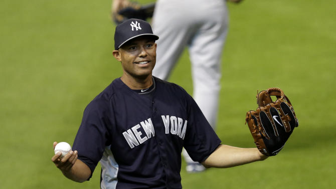 New York Yankees relief pitcher Mariano Rivera talks to the fans before a baseball game against the Houston Astros Saturday, Sept. 28, 2013, in Houston. Rivera is retiring at the end of the season. (AP Photo/David J. Phillip)