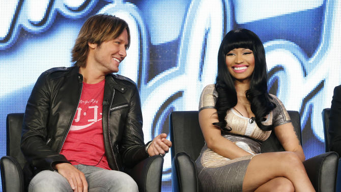 """CORRECTS DAY AND DATE  - Keith Urban and Nicki Minaj from """"American Idol"""" attend the Fox Winter TCA Tour at the Langham Huntington Hotel on Tuesday, Jan. 8, 2013, in Pasadena, Calif. (Photo by Todd Williamson/Invision/AP)"""