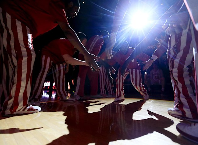 Indiana&#39;s Victor Oladipo is greeted by teammates during introductions before an NCAA college basketball game against Ohio State, Tuesday, March 5, 2013, in Bloomington, Ind. (AP Photo/Darron Cummings)
