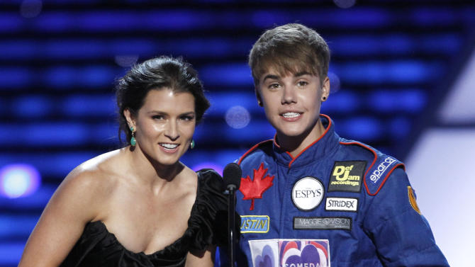 L to R, Danica Patrick and Justin Bieber present the award for Best Team at the ESPY Awards on Wednesday, July 13, 2011, in Los Angeles. (AP Photo/Matt Sayles)