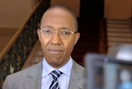 "Senegalese ex-banker and business executive Abdoul Mbaye speaks to the press after he was appointed as the new prime minister in Dakar. ""Abdoul Mbaye is named prime minister,"" said a presidential decree read by the secretary general of the new Senegalese government, whose lineup was expected to be announced later today"