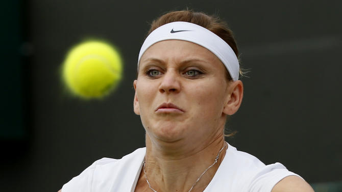 Lucie Safarova of the Czech Republic keeps her eye on the ball during her match against Coco Vandeweghe of the U.S.A. at the Wimbledon Tennis Championships in London