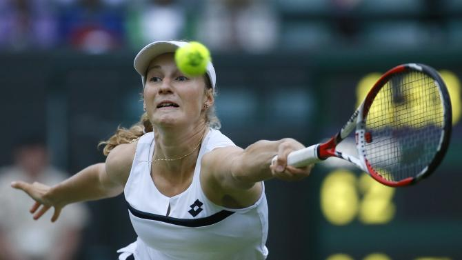 Ekaterina Makarova of Russia plays a return to Petra Kvitova of Czech Republic during their Women's singles match at the All England Lawn Tennis Championships in Wimbledon, London, Friday, June 28, 2013. (AP Photo/Kirsty Wigglesworth)