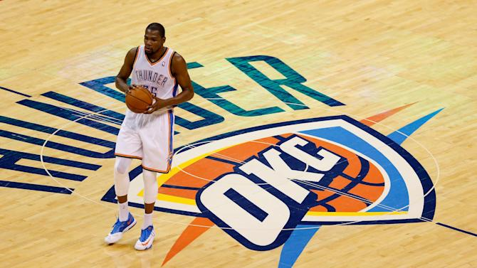 Kevin Durant of the Oklahoma City Thunder brings the ball up court against the San Antonio Spurs in the first half during Game Four of the Western Conference Finals of the 2014 NBA Playoffs at Chesapeake Energy Arena on May 27, 2014 in Oklahoma City
