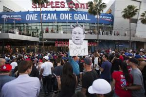 A photo cutout of Los Angeles Clippers owner Sterling is seen among people standing in line for the NBA playoff game 5 in Los Angeles