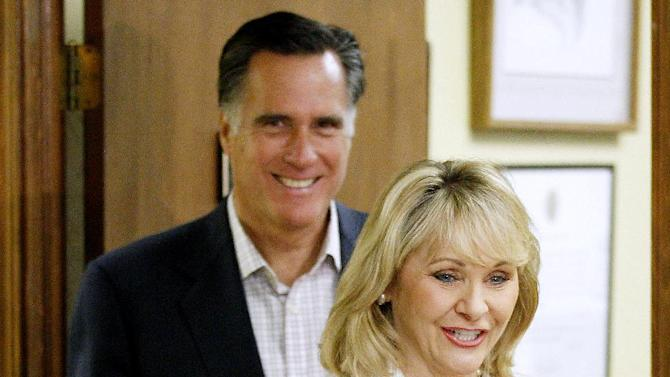 FILE - In this May 9, 2012 file photo, Republican presidential candidate, former Massachusetts Gov. Mitt Romney follows Oklahoma Gov. Mary Fallin in Oklahoma City. While Romney faults President Barack Obama for a weak American economy, Republican governors across the country are merrily trumpeting tales of business growth and falling employment. (AP Photo/Sue Ogrocki, File)
