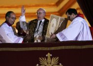 Newly elected Pope Francis (C), Cardinal Jorge Mario Bergoglio of Argentina appears on the balcony of St. Peter&#39;s Basilica after being elected by the conclave of cardinals, at the Vatican, March 13, 2013. White smoke rose from the Sistine Chapel chimney and the bells of St. Peter&#39;s Basilica rang out on Wednesday, signaling that Roman Catholic cardinals had elected a pope to succeed Benedict XVI.      REUTERS/Tony Gentile (VATICAN  - Tags: RELIGION)