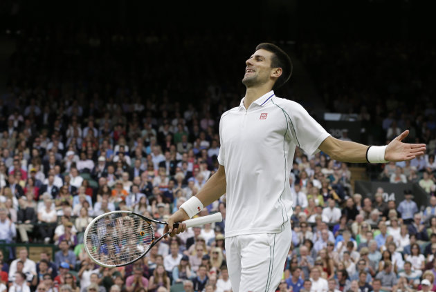 Novak Djokovic of Serbia reacts to a shot by Radek Stepanek of the Czech Republic during a third round men's singles match at the All England Lawn Tennis Championships at Wimbledon, England, Friday, June 29, 2012. (AP Photo/Alastair Grant)