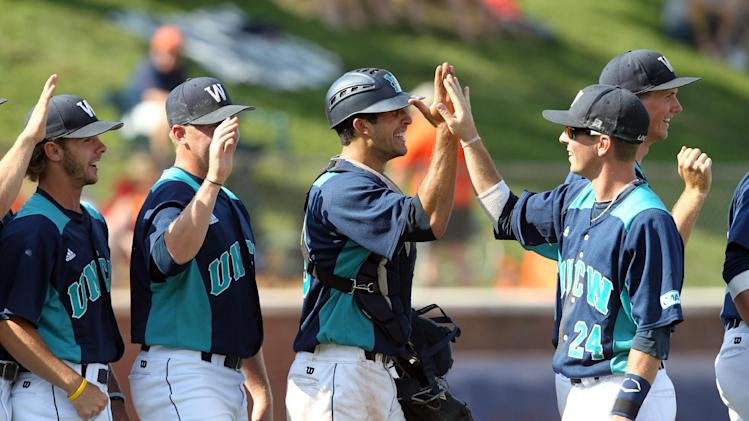 CORRECTS DATE - UNC Wilmington players celebrate the 9-5 win over Army in an NCAA college baseball tournament regional game in Charlottesville, Va., Saturday, June 1, 2013. (AP Photo/Andrew Shurtleff)