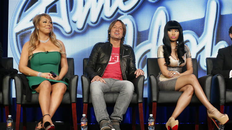 "In this Jan. 8, 2013 photo, from left, Mariah Carey, Keith Urban and Nicki Minaj from ""American Idol"" attend the Fox Winter TCA Tour at the Langham Huntington Hotel, in Pasadena, Calif. ""American Idol"" returns Wednesday, Jan. 16, 2013, for season 12. (Photo by Todd Williamson/Invision/AP)"