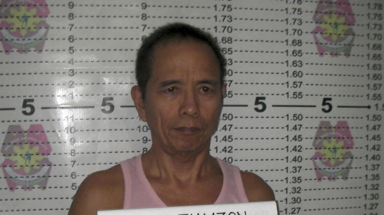 In this Saturday, March 22, 2014 photo released by the Philippine National Police Public Information Office, suspected communist leader, Benito Tiamzon, has his mugshot taken in Cebu province, central Philippines. Philippine officials said Sunday they will not release two leaders of a violent rebel group fighting to overthrow the government, whose arrests were a major setback for the long-running insurgency. (AP Photo/Philippine National Police, Public Information Office)