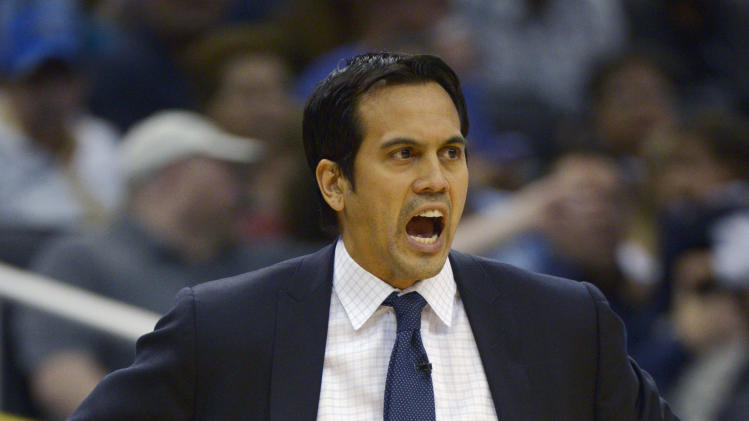 Miami Heat head coach Erik Spoelstra shouts out instructions during the first half of an NBA basketball game against the Orlando Magic in Orlando, Fla., Monday, March 25, 2013. The Heat won 108-94. (AP Photo/Phelan M. Ebenhack)