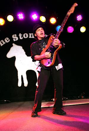 "In this May 6, 2011 photo provided by John Cavanaugh, guitarist Nils Lofgren performs on stage at the Stone Pony in Asbury Park, N.Y.  Lofgren, whose latest album is entitled ""Old School,"" is preparing for another tour with Bruce Springsteen and the E Street Band. (AP Photo/John Cavanaugh) NO SALES"