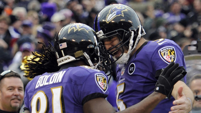 Baltimore Ravens wide receiver Anquan Boldin (81) celebrates his touchdown catch with quarterback Joe Flacco (5) during the second half of an NFL wild card playoff football game against the Indianapolis Colts Sunday, Jan. 6, 2013, in Baltimore. (AP Photo/Nick Wass)