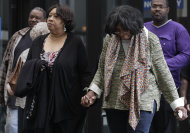 Supporters of Jennifer Hudson arrive at Cook County Criminal Court, Wednesday, May 9, 2012, in Chicago as closing arguments begin in the murder trial of William Balfour. Balfour, is charged in the 2008 murder of Oscar and Grammy winning performer Jennifer Hudson&#39;s mother, brother and nephew. (AP Photo/M. Spencer Green)