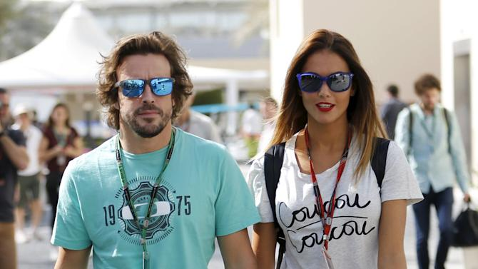 McLaren Formula One driver Fernando Alonso of Spain and Lara Alvarez arrive at Yas Marina circuit before the start of the Abu Dhabi Grand Prix