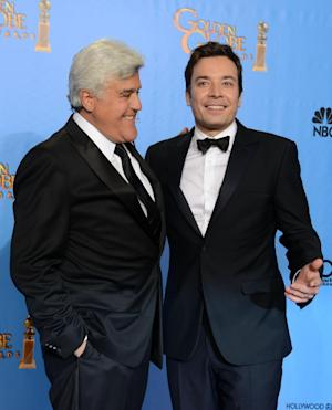 """File- This Jan. 13, 2013, file photo shows presenters Jimmy Fallon, left, and Jay Leno posing backstage at the 70th Annual Golden Globe Awards at the Beverly Hilton Hotel in Beverly Hills, Calif. Leno will close out his 22-year run as host of NBC's """"The Tonight Show"""" with a nod to the future and to the past. His heir apparent, Fallon, will kick off Leno's final week with a guest appearance on Feb. 3. Fallon is taking over the gig after hosting NBC's """"Late Night"""" since 2009. (Photo by Jordan Strauss/Invision/AP)"""