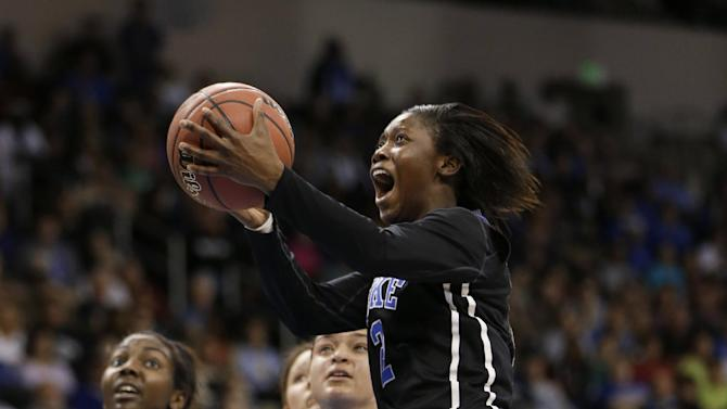 Duke guard Alexis Jones (2) takes a shot in front of Notre Dame guard Kayla McBride during the first half of the regional final game of the NCAA women's college basketball tournament Tuesday, April 2, 2013, in Norfolk, Va. (AP Photo/Steve Helber)
