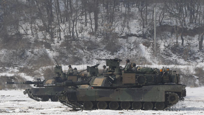 U.S. tanks move during a military exercise near the demilitarized zone between South and North Koreas, in Paju, South Korea, Thursday, Dec. 13, 2012. North Korea successfully fired a long-range rocket on Wednesday, defying international warnings as the regime of Kim Jong Un took a big step forward in its quest to develop a nuclear missile. (AP Photo/Ahn Young-joon)