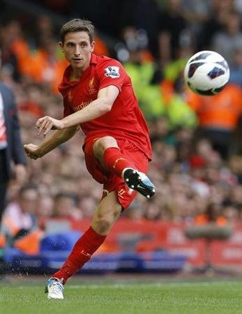 Liverpool's Joe Allen passes the ball during their English Premier League soccer match against Manchester City at Anfield in Liverpool