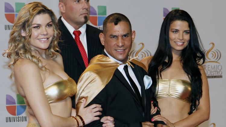 """FILE - In this Feb. 16, 2012 file photo former boxing champion Hector """"Macho"""" Camacho, front center, poses for photographers at his arrival to the Premio Lo Nuestro Music Awards in Miami. Police in Puerto Rico say Camacho has been shot and critically wounded Tuesday, Nov. 20, 2012. (AP Photo/Alan Diaz, File)"""
