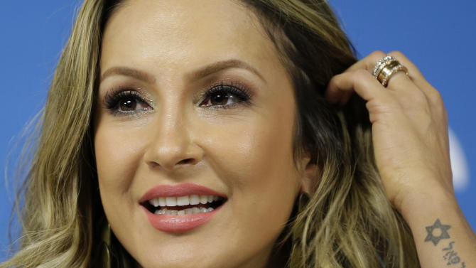 Brazilian singer Claudia Leitte speaks during a press conference one day before the World Cup opening ceremony in Sao Paulo, Brazil, Wednesday, June 11, 2014. Leitte will perform with Pitbull and Jennifer Lopez at the opening ceremony on Thursday. (AP Photo/Felipe Dana)