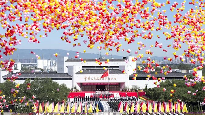 In this photo released by China's Xinhua news agency, balloons are released into the air during a ceremony to mark the 69th anniversary of China's victory over Japan at the Museum of the War of Chinese People's Resistance Against Japanese Aggression, in Beijing Wednesday, Sept. 3, 2014. China commemorated Japan's World War II surrender as part of Beijing's campaign to remind the world of Tokyo's historical aggression amid worsening relations between the two countries. (AP Photo/Xinhua, Wang Ye) NO SALES
