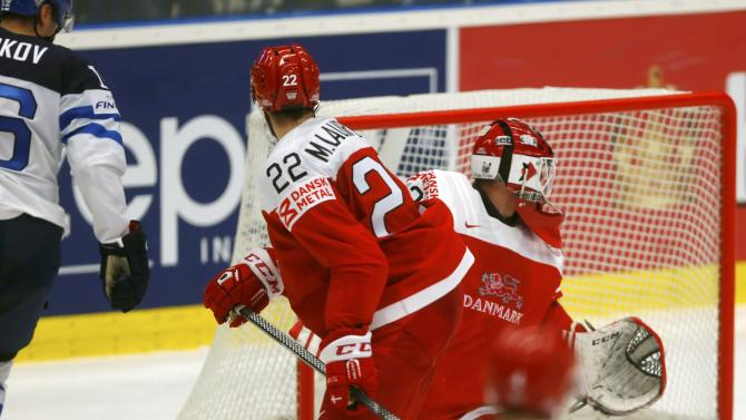 Denmark's goaltender Dahm fails to save a goal of Finland's Barkov as Denmark's Lauridsen looks on during their Ice Hockey World Championship game at the CEZ arena in Ostrava