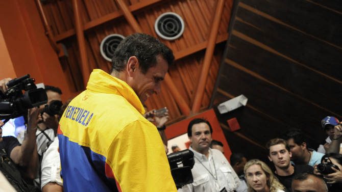 Opposition presidential candidate Henrique Capriles is greeted by supporters after he conceded defeat in the presidential elections at his campaign headquarters in Caracas, Venezuela, Sunday, Oct. 7, 2012.  Venezuela's electoral council said late Sunday President Hugo Chavez has won re-election, defeating challenger Henrique Capriles.(AP Photo/Sharon Steinmann)