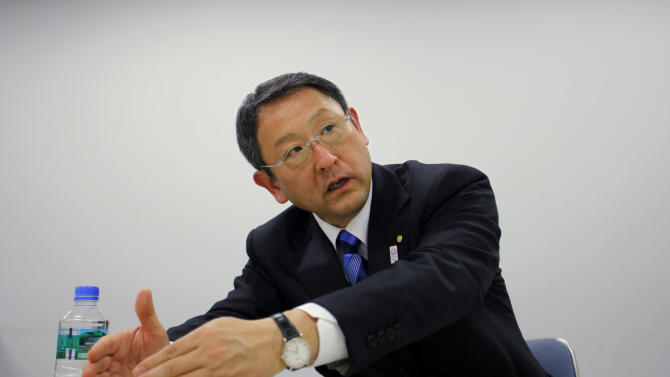 In this Wednesday, March 6, 2013 photo, Toyota Motor Corp. President Akio Toyoda speaks during an interview in Tokyo. In the exclusive interview with The Associated Press, Toyota's president said he is putting new auto plant openings on hold for three years and reshaping the automaker's structure to give more autonomy to regional divisions and foreign executives. (AP Photo/Junji Kurokawa)