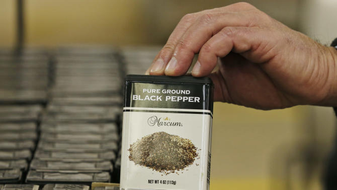 A can of ground pepper is displayed form a pallet of the product during a tour of the C.F. Sauer spice and extract plant in Richmond, Va., Thursday, Dec. 4, 2014.  The Richmond-based spice and condiment company is among more than 200 other Virginia companies that are turning to international markets with the help of a unique state-run program.  (AP Photo/Steve Helber)