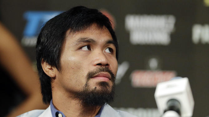 Manny Pacquiao listens to comments during a news conference, Wednesday, Dec. 5, 2012, in Las Vegas. Pacquiao is scheduled to take on Juan Manuel Marquez in a welterweight boxing match on Saturday. (AP Photo/Julie Jacobson)