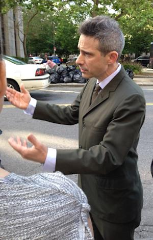 """Rapper Adam """"Ad-Rock"""" Horovitz gestures to someone outside a New York City courthouse after a jury awarded the """"Beastie Boys"""" $1.7 million in a copyright violation case against beverage-maker Monster Energy Co., Thursday, June 5, 2014. Monster had admitted wrongly using Beastie Boys songs in a video that was online for five weeks. But the beverage maker insisted it should owe no more than $125,000. (AP Photo/Larry Neumeister)"""