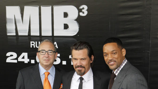 """Director Barry Sonnenfeld, left, and actors Will Smith, right, and Josh Brolin pose for photographers at a cinema during a photocall for their film """"Men in Black 3"""" in Moscow, Russia, Friday, April 18, 2012. The film premiere in Russia is scheduled for May 24. (AP Photo/Misha Japaridze)"""