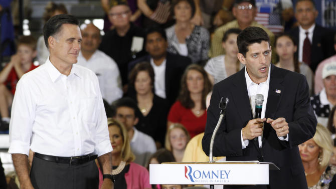 Republican Presidential candidate, Mitt Romney, left, his running mate, Rep. Paul Ryan, R-Wis., speaks during a rally at Randolph-Macon College in Ashland, Va., Saturday, Aug. 11, 2012.  ( AP Photo/Steve Helber)