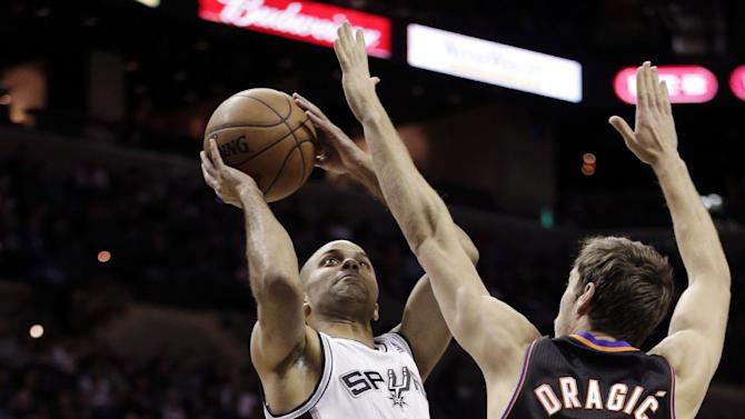 San Antonio Spurs' Tony Parker (9), of France, shoots over Phoenix Suns' Goran Dragic (1), of Slovenia, during the first half of an NBA basketball game, Wednesday, Feb. 27, 2013, in San Antonio. (AP Photo/Eric Gay)