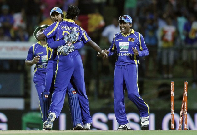 Sri Lanka's captain Mahela Jayawardene, Shaminda Eranga and Dinesh Chandimal celebrate taking the wicket of India's Gautam Gambhir during their Twenty20 match in Pallekele