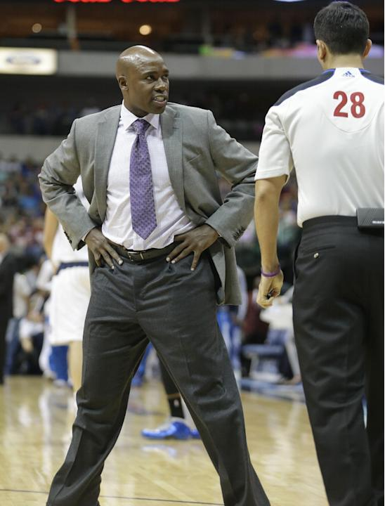 Orlando Magic head coach Jacque Vaughn argues a call during the first half of an NBA preseason basketball game against the Dallas Mavericks in Dallas,  Monday, Oct. 14, 2013