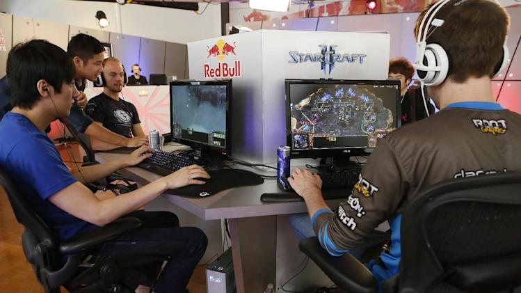 """In this photo taken Friday, June 21, 2013, legendary """"WarCraft 3"""" player, Jo """"Golden"""" Myeong Hwan, from South Korea, left, joins seven of the world's best """"StarCraft II"""" video game players to train at Red Bull Training Grounds, held at Red Bull North America headquarters in Santa Monica, Calif. The Red Bull TV e-sports series included live-streamed scrimmages and a tournament with $8,600 in prize money. (AP Photo/Damian Dovarganes)"""