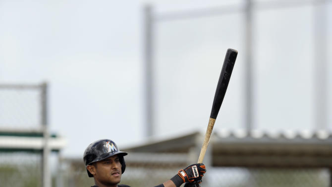 Miami Marlins' Donovan Solano takes live batting practice during spring training baseball practice Sunday, March 1, 2015, in Jupiter, Fla. (AP Photo/Jeff Roberson)