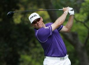 Britain's Lee Westwood hits his tee shot on the second hole during the final round of the Masters golf tournament at the Augusta National Golf Club in Augusta