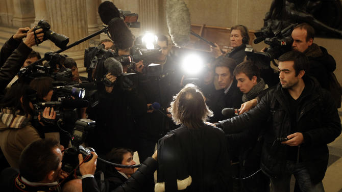 Civil party lawyer Jean-Claude Guidicelli, center, answers to journalists at the Lyon's courthouse, central France, at the end of the trial of Regis de Camaret, Friday, Nov. 23, 2012. The former tennis coach Regis de Camaret has been convicted and sentenced to eight years in prison for raping two young players attending the academy he used to run in Saint-Tropez. The case began with a book by Isabelle Demongeot, who described years of abuse. Several other women later came forward with accusations that the now-70-year-old Camaret raped or abused them when they trained in the 1980s and 1990s. The statute of limitations had run out for most of the accusers. (AP Photo/Laurent Cipriani)